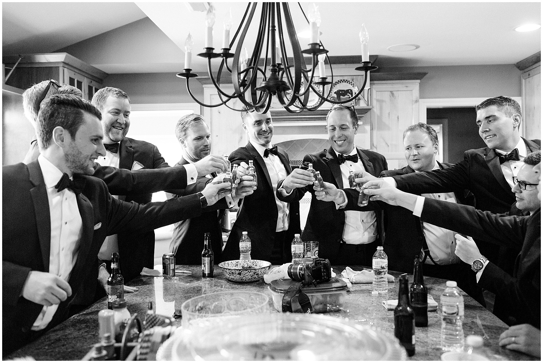 The groomsmen share a toast before a Glen Club Glenview Illinois wedding.