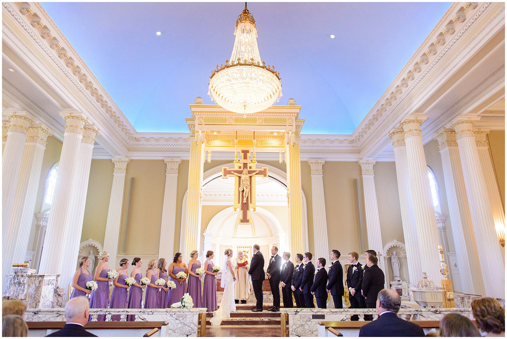 The bridal party stands at the altar of Our Lady of Perpetual Hope during a Glen Club Glenview Illinois wedding.