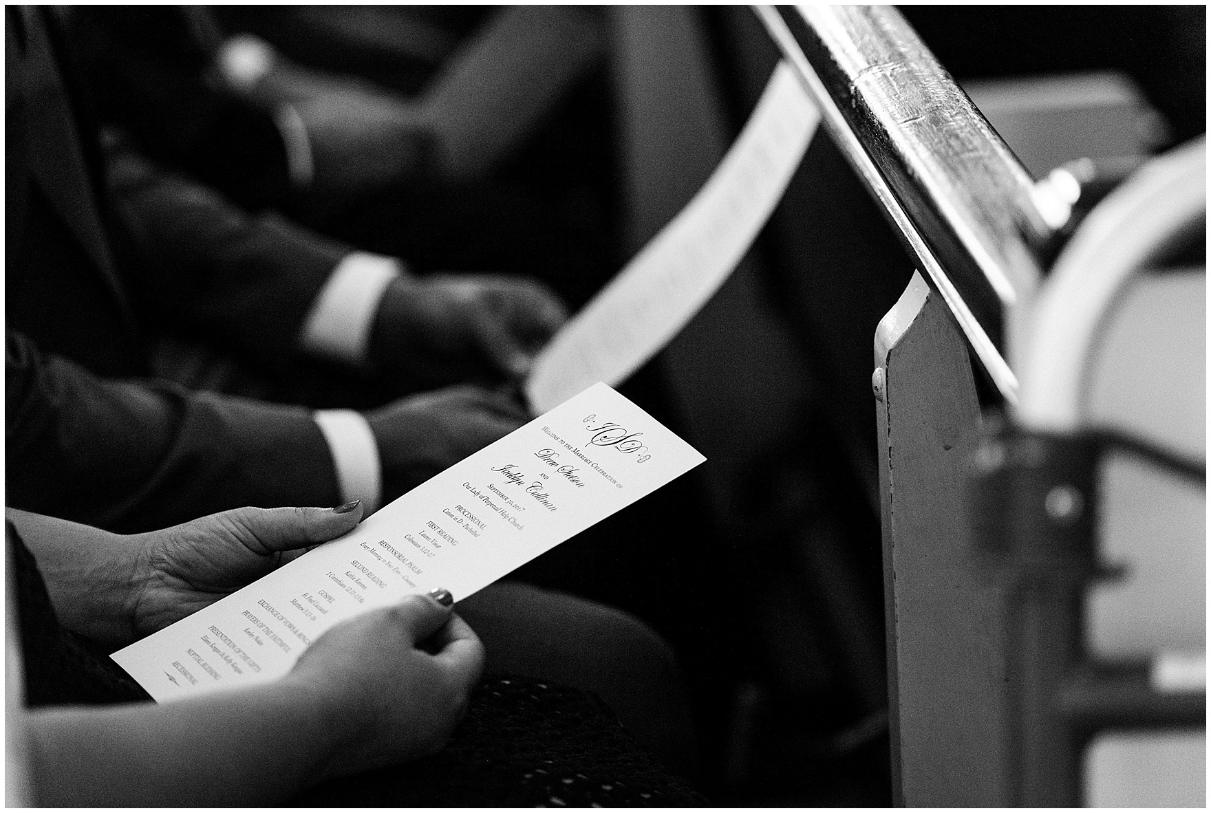 A guest reads a program during a Glen Club Glenview Illinois wedding.