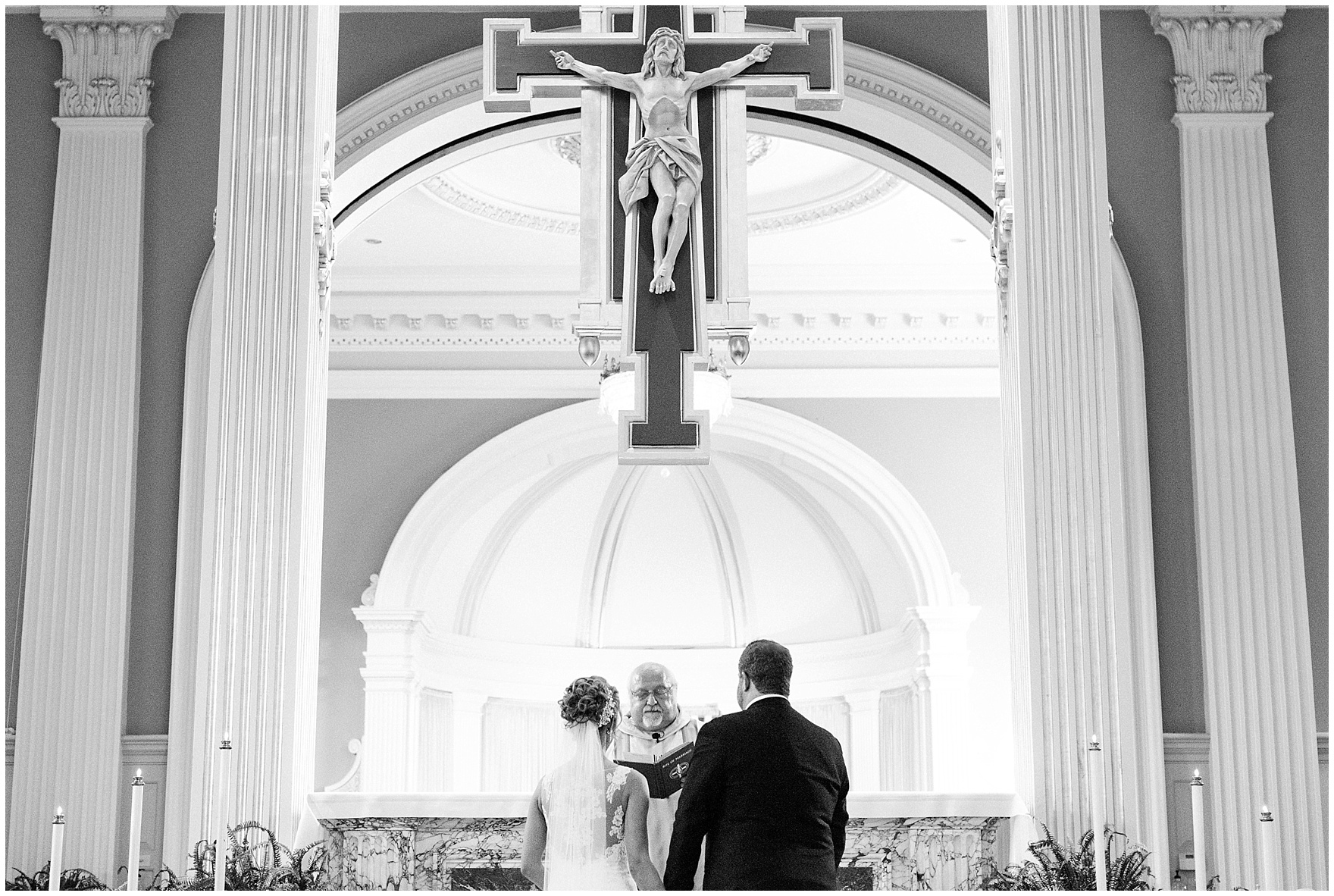 The bride and groom stand hand in hand at the altar during a Glen Club Glenview Illinois wedding.