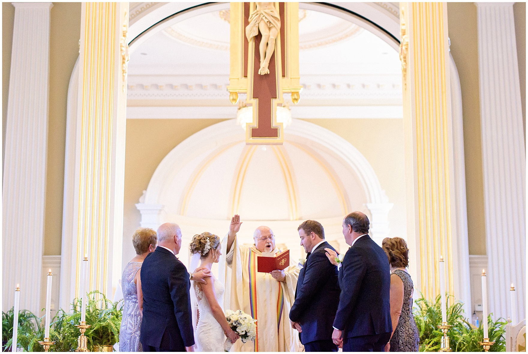 Family prays around the bride and groom during a Glen Club Glenview Illinois wedding.