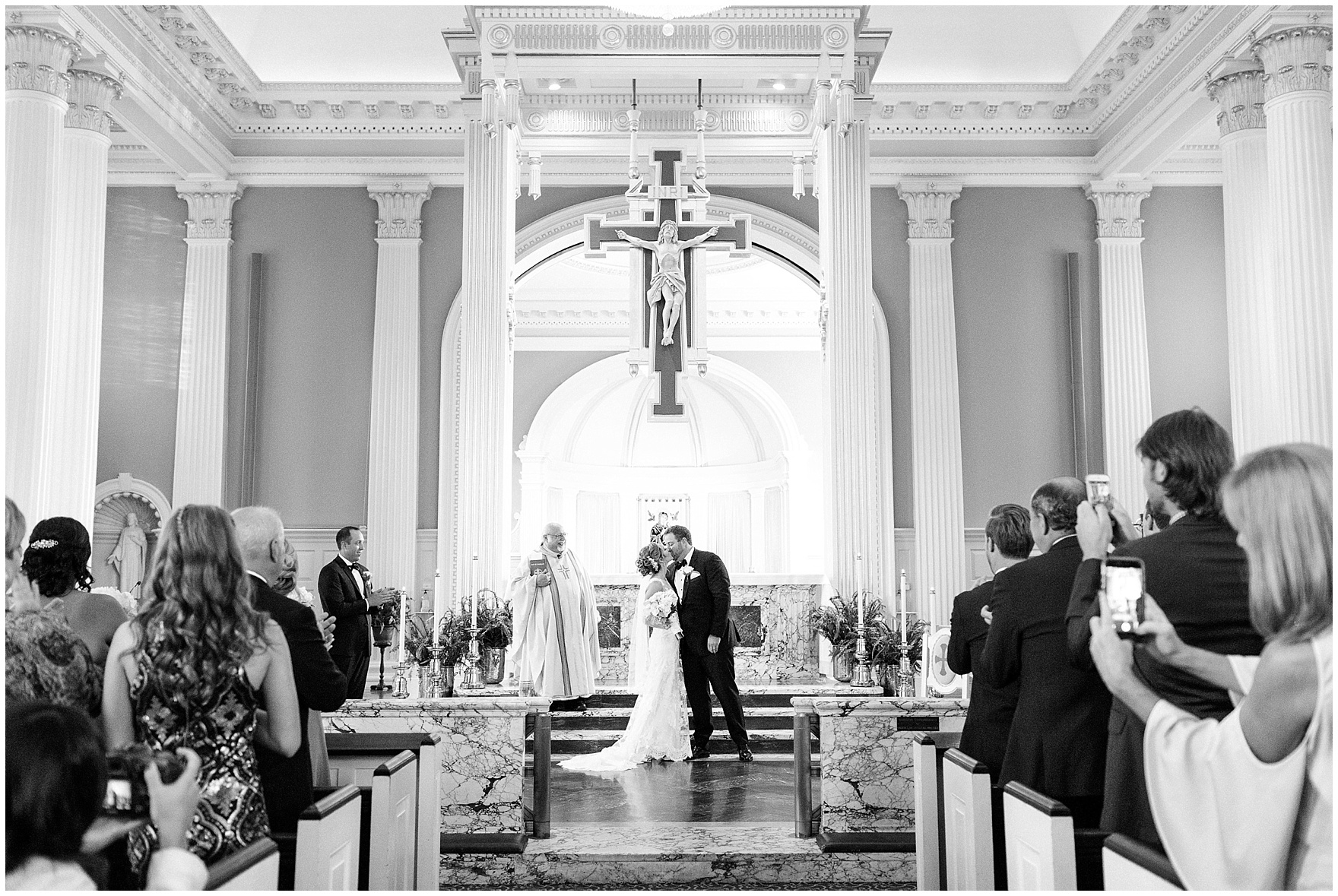 The bride and groom share their first kiss during a Glen Club Glenview Illinois wedding.
