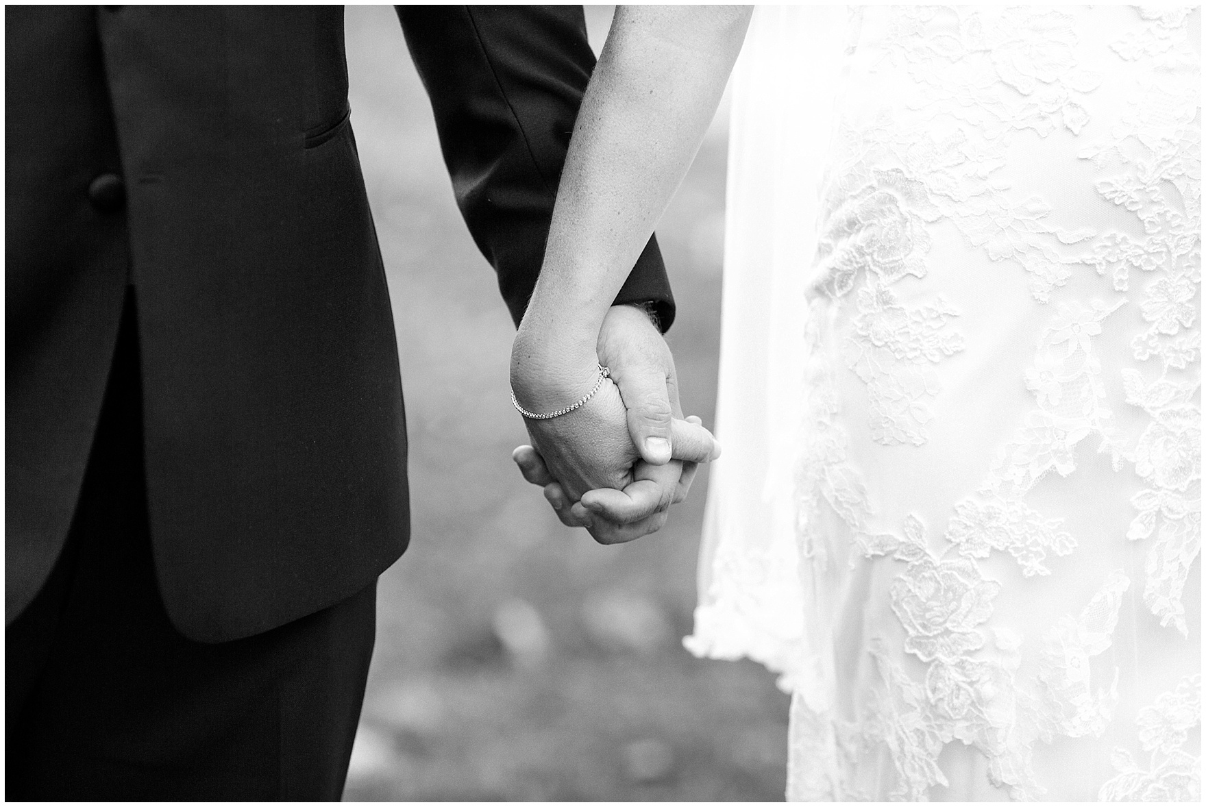 The bride and groom hold hands and pose for portraits during a Glen Club Glenview Illinois wedding.