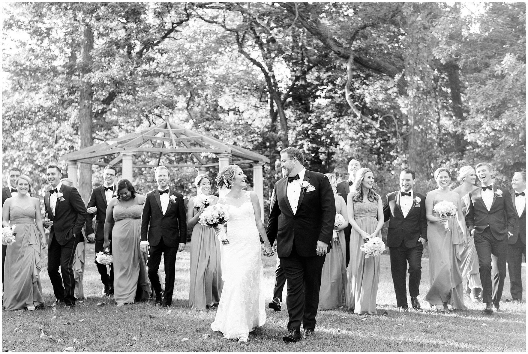 The bridal party poses for portraits during a Glen Club Glenview Illinois wedding.