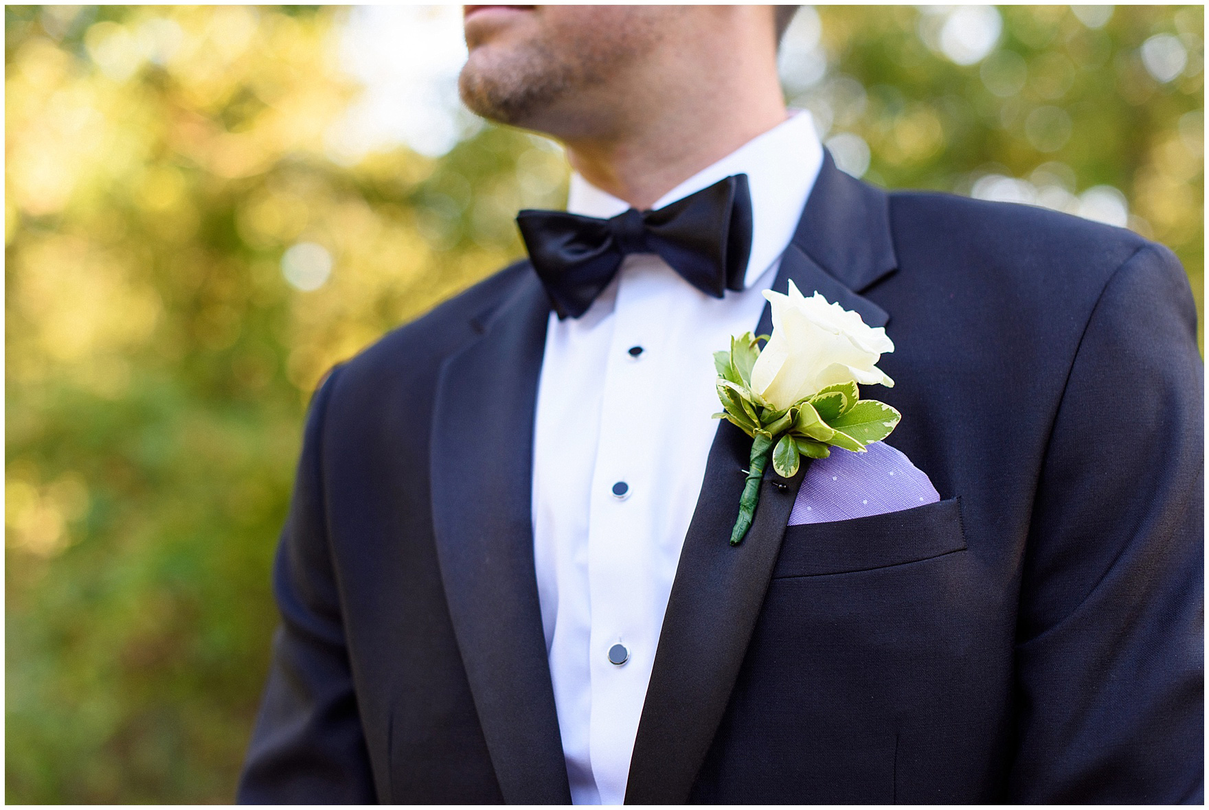 Detail of a groomsman's boutonniere and pocket square during a Glen Club Glenview Illinois wedding.