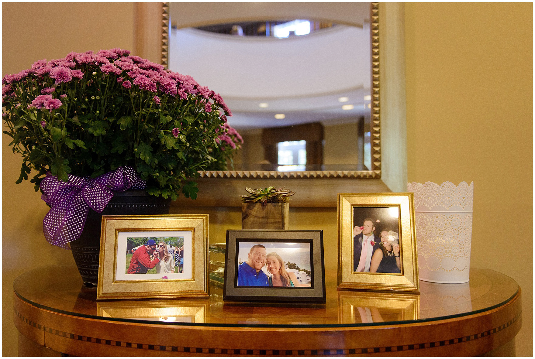 Framed photos and flowers decorate the reception for a Glen Club Glenview Illinois wedding.