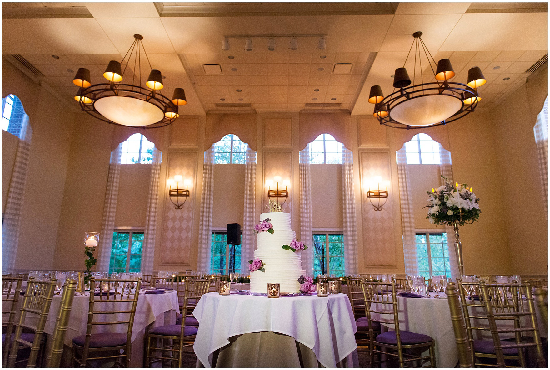 A tiered cake with lavender flowers for a Glen Club Glenview Illinois wedding.