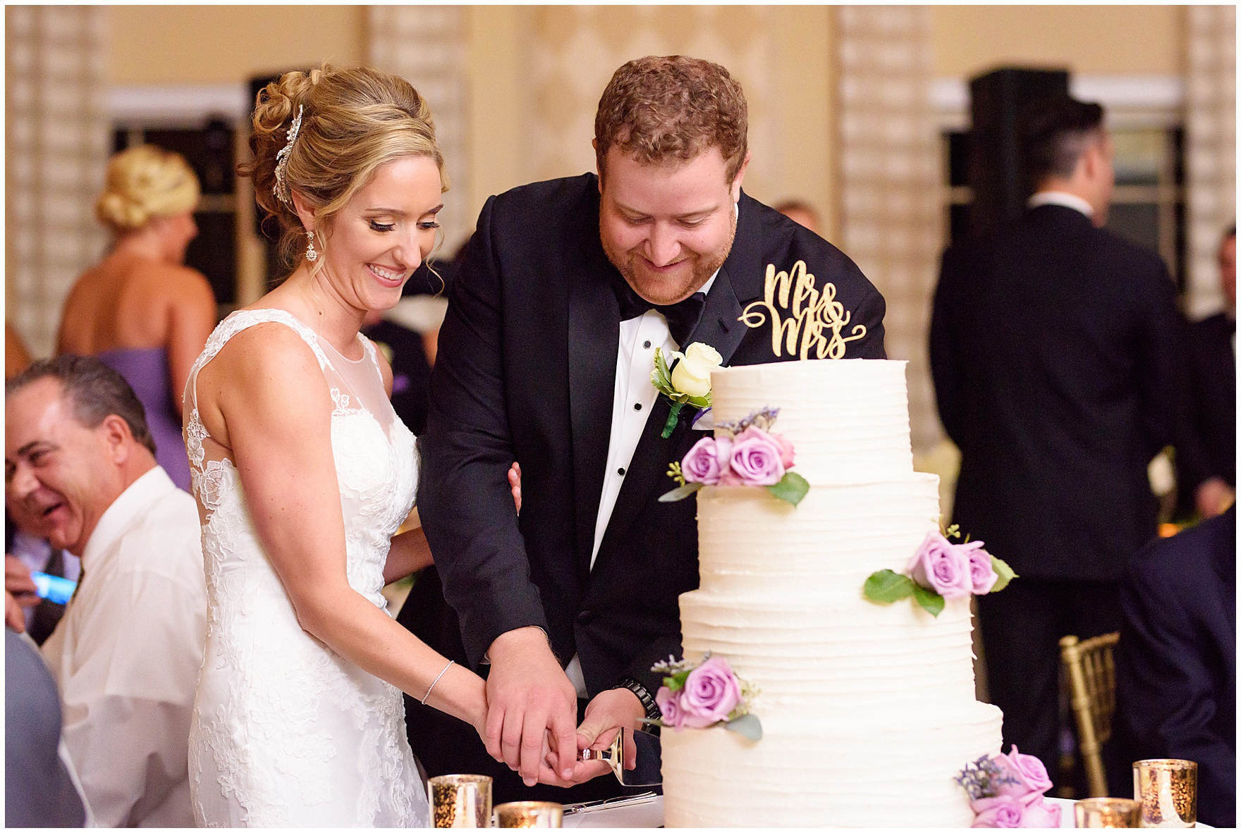 The bride and groom cut their cake during a Glen Club Glenview Illinois wedding.