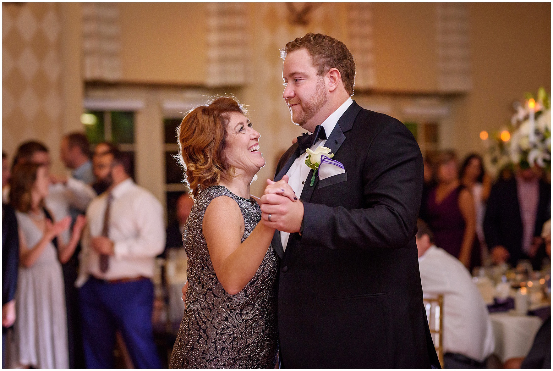 The groom dances with his mother at a Glen Club Glenview Illinois wedding.