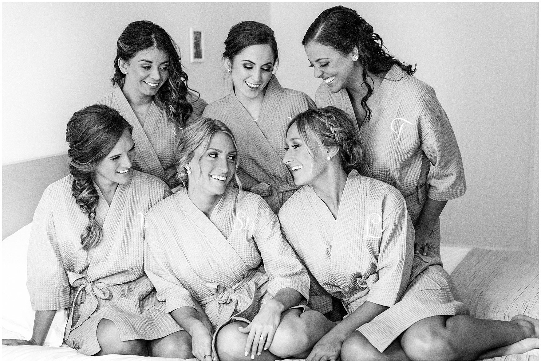 A bride and her bridesmaids in matching robes at the Ambassador Hotel before a St. Clement Germania Place Chicago wedding.