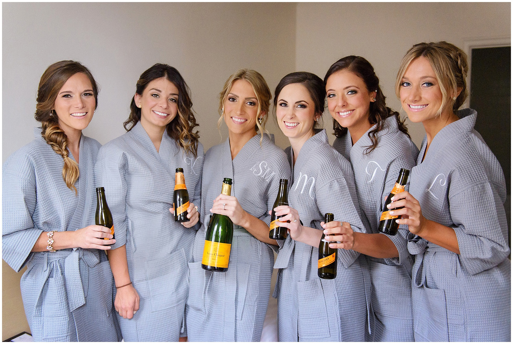 A bride and her bridesmaids drink Veuve Clicquot at the Ambassador Hotel before a St. Clement Germania Place Chicago wedding.