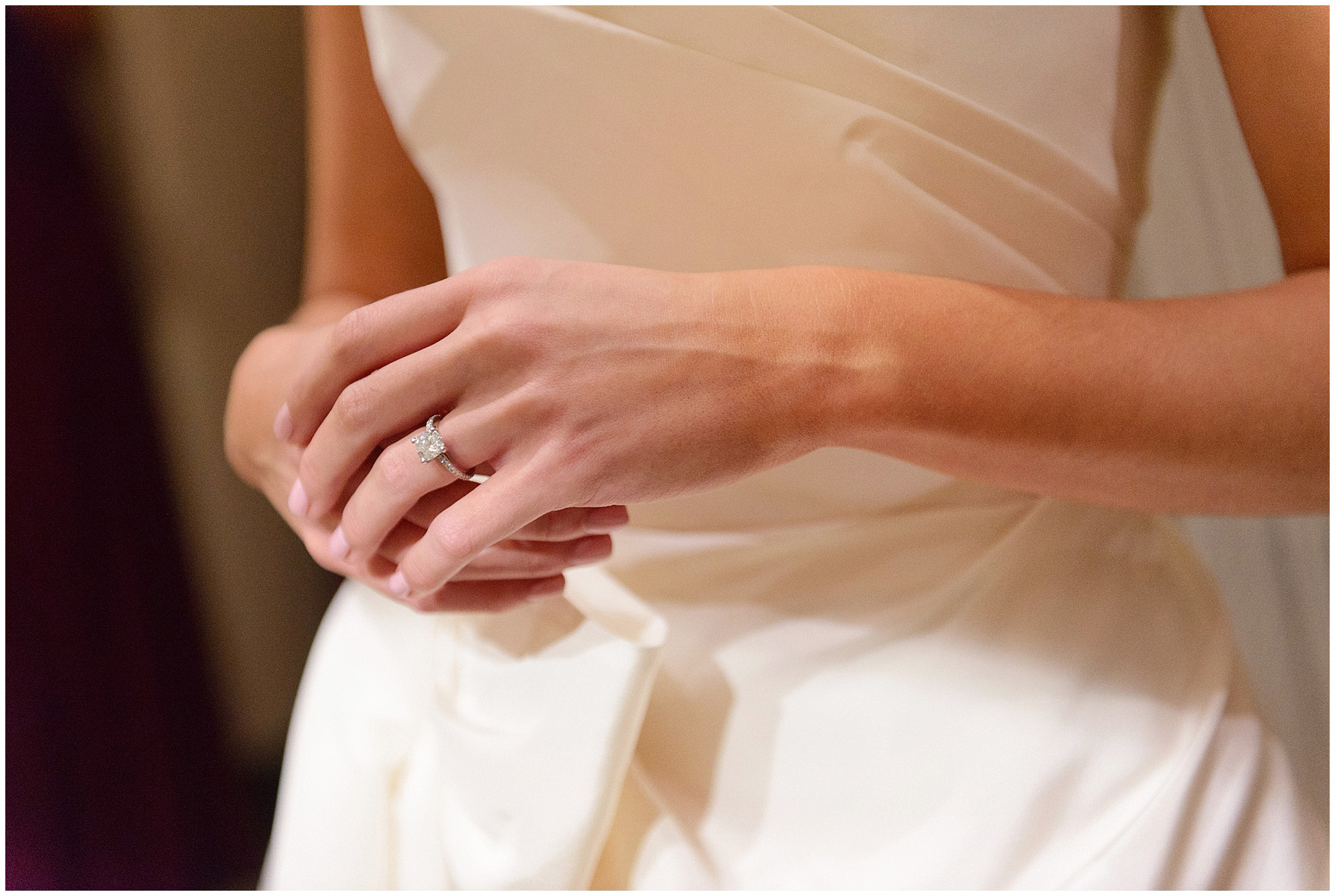 A bride takes a moment to reflect before a St. Clement Germania Place Chicago wedding.
