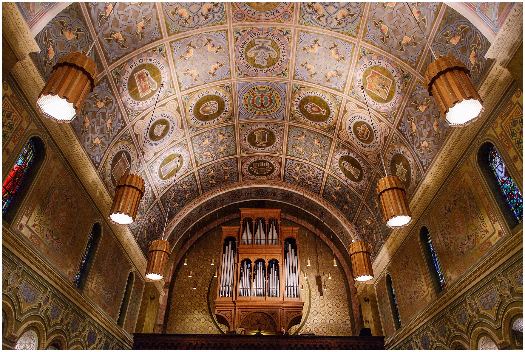 The beautiful gold painted church ceiling at a St. Clement Germania Place Chicago wedding.