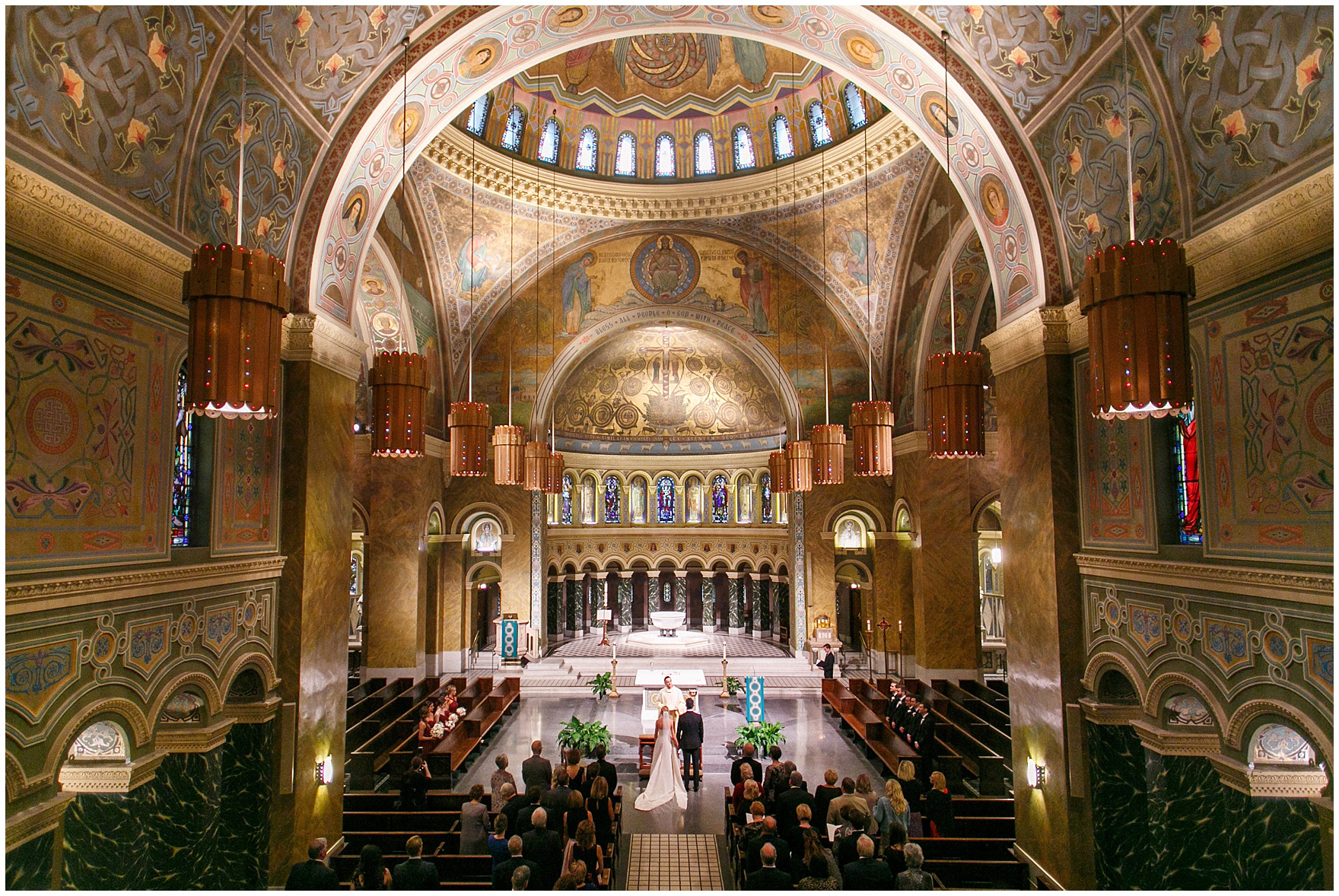 A photograph of the bride and groom at the altar during a St. Clement Germania Place Chicago wedding.