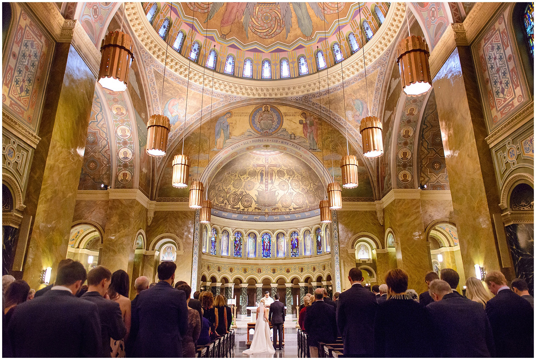 Photograph of the bride and groom standing at the altar during a St. Clement Germania Place Chicago wedding.