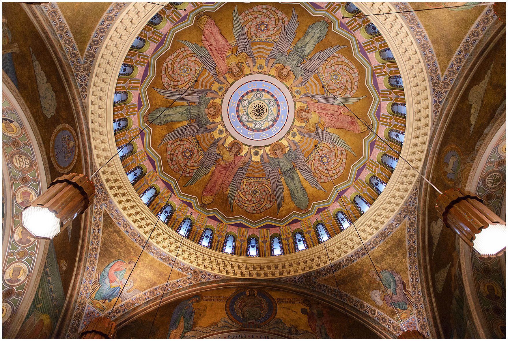The beautiful and ornate ceiling of the church during a St. Clement Germania Place Chicago wedding.