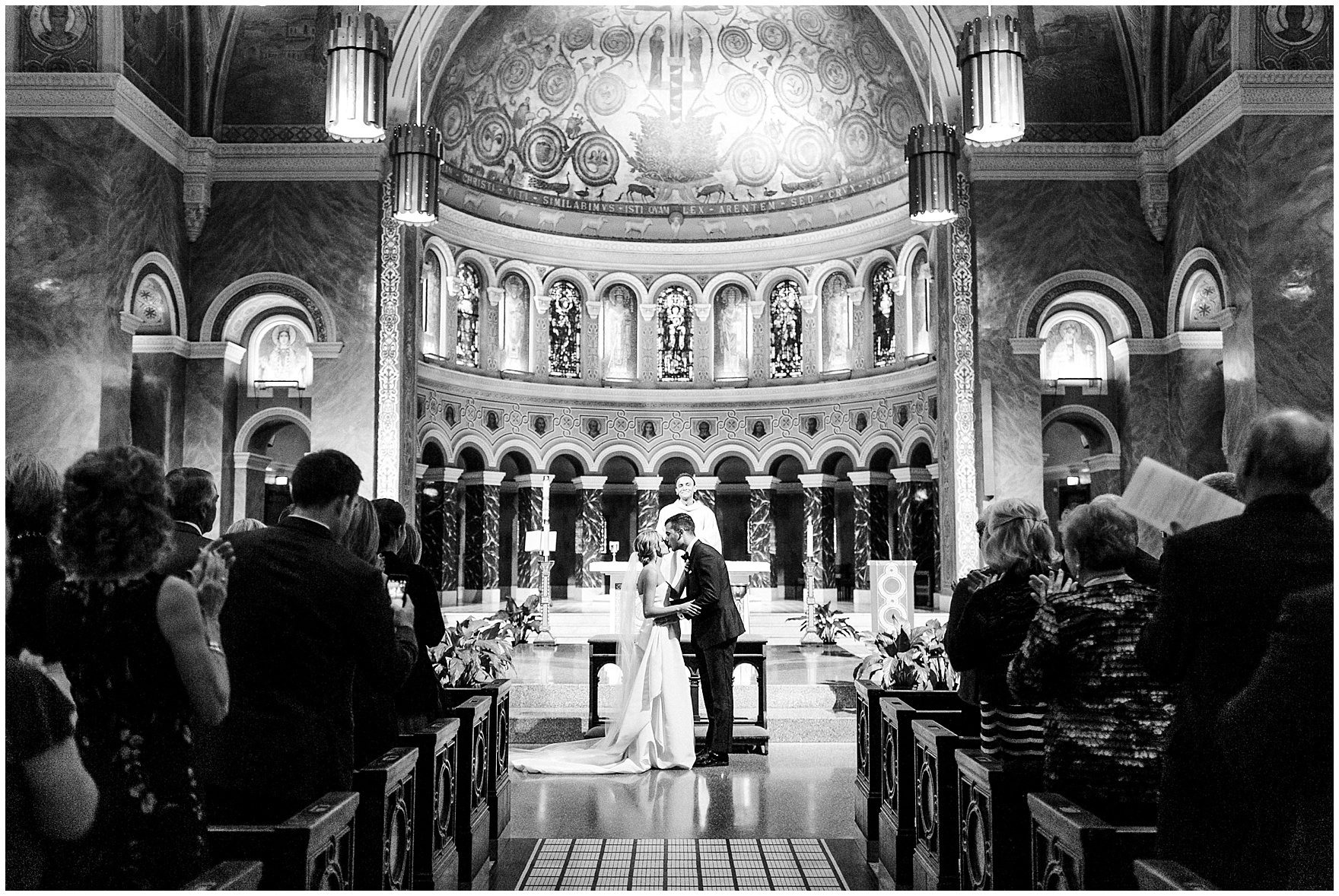 The bride and groom share their first kiss during a St. Clement Germania Place Chicago wedding.
