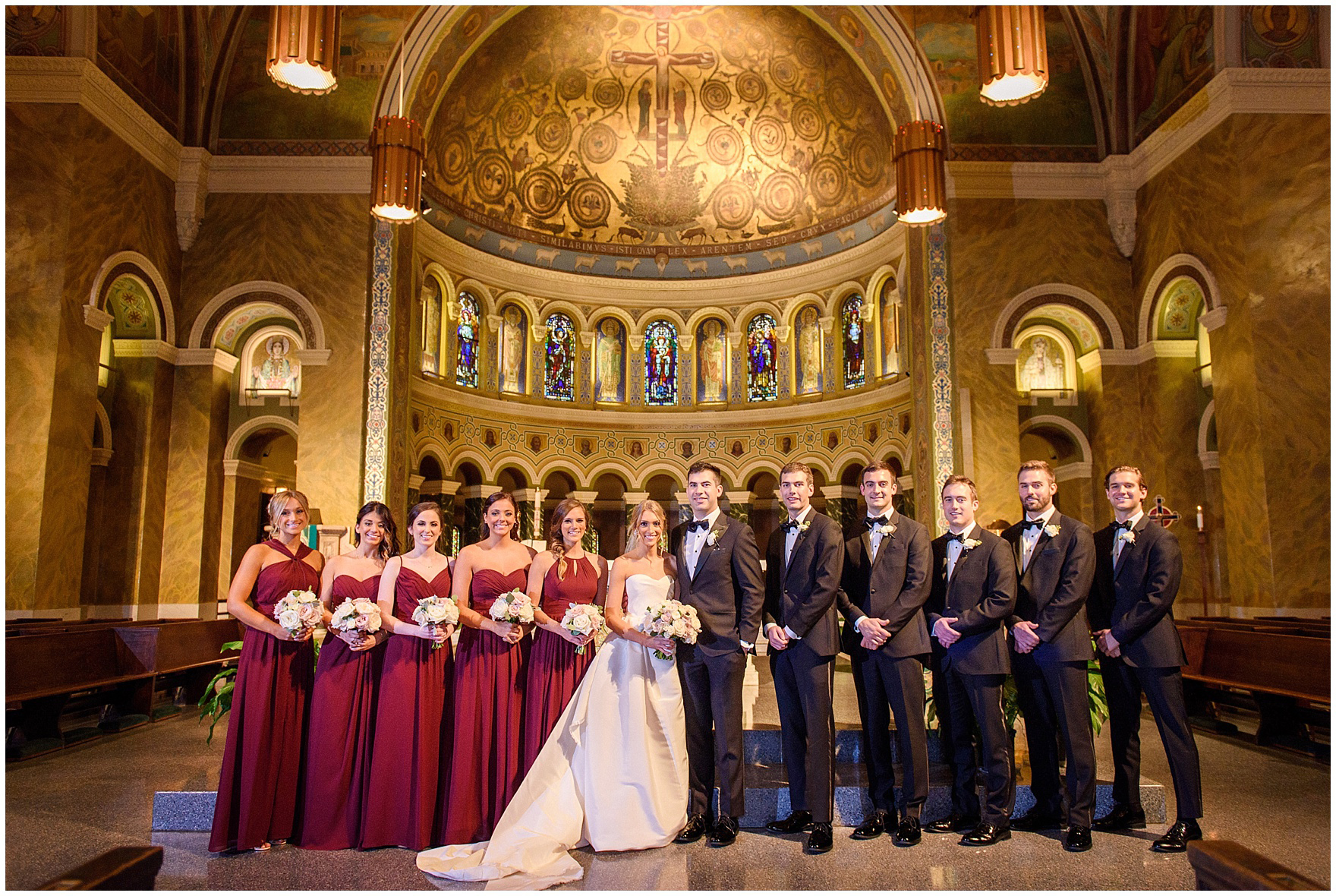 The entire bridal party poses on the altar of the church during a St. Clement Germania Place Chicago wedding.