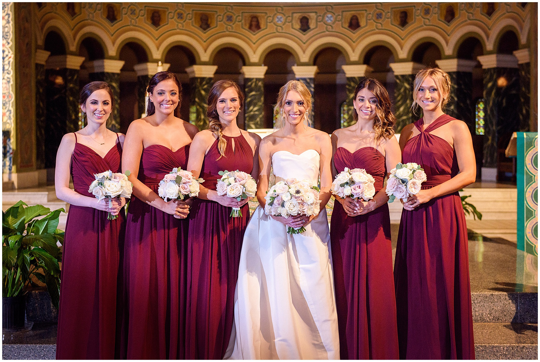 The bride and bridesmaids pose at the church during a St. Clement Germania Place Chicago wedding.