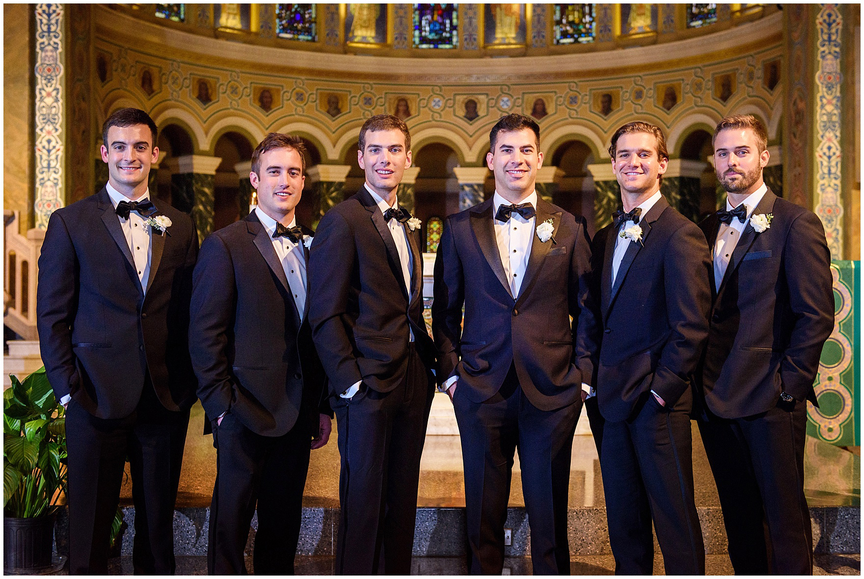 The groom and groomsmen pose at the altar during a St. Clement Germania Place Chicago wedding.