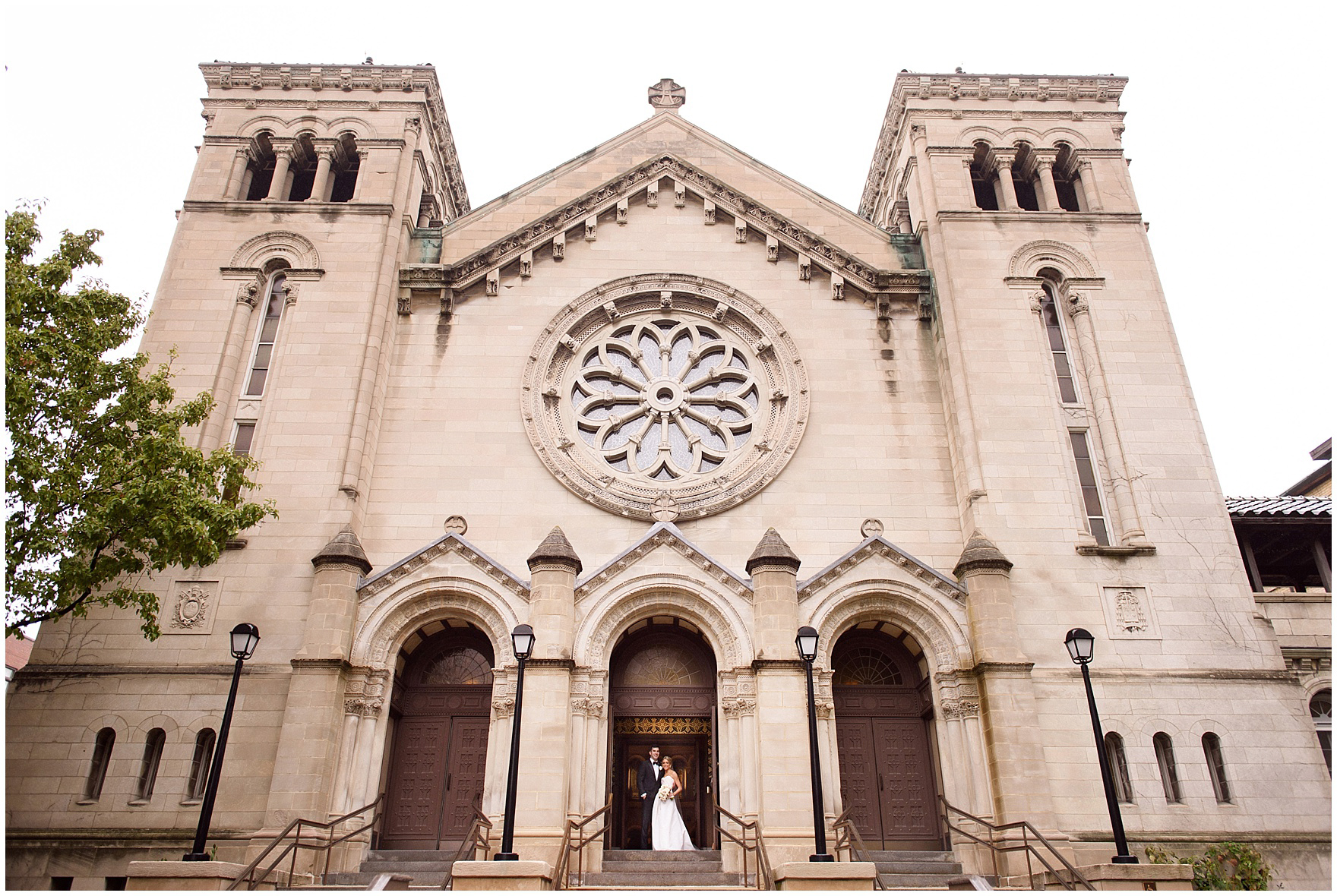 The bride and groom stand in the church entry during a St. Clement Germania Place Chicago wedding.