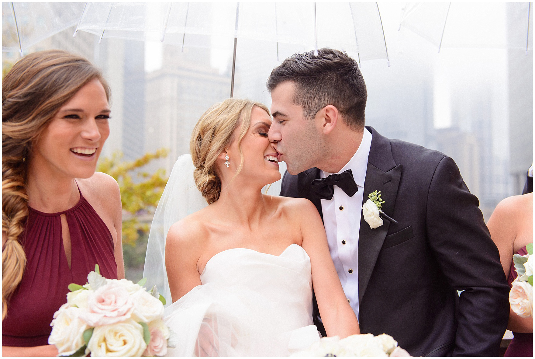 The bride and groom joke and he kisses her on the nose downtown Chicago during a St. Clement Germania Place Chicago wedding.