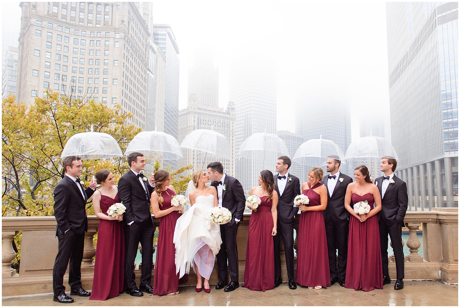 A bridal party stands along the Chicago River during a St. Clement Germania Place Chicago wedding.