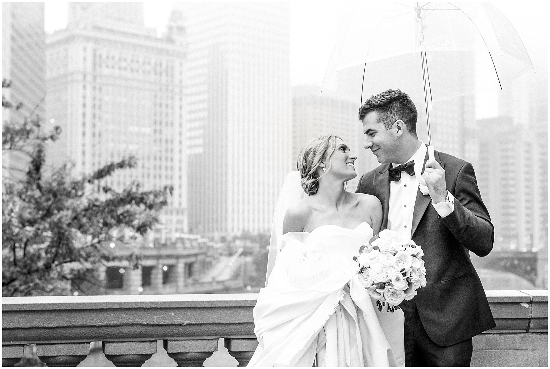 A bride and groom pose along Chicago's River during a St. Clement Germania Place Chicago wedding.