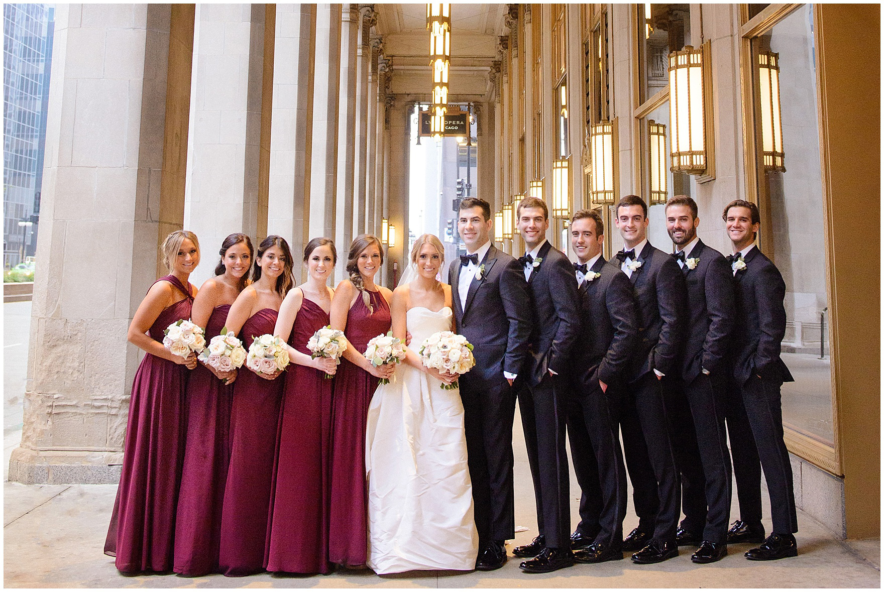 The bridal party is photographed at the Civic Opera House during a St. Clement Germania Place Chicago wedding.
