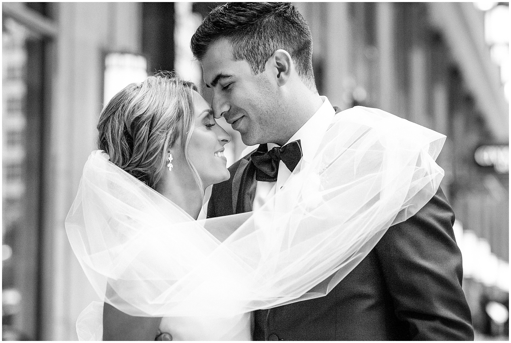 The bride and groom enjoy a quiet moment during portraits during a St. Clement Germania Place Chicago wedding.