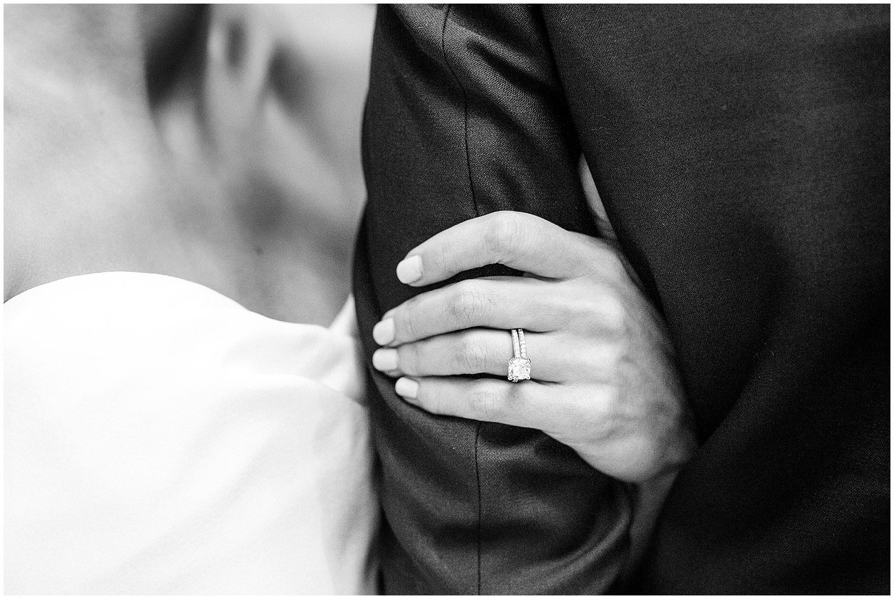 The bride holds the groom's arm close during a St. Clement Germania Place Chicago wedding.