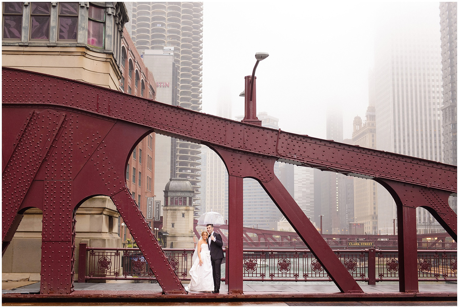 The bride and groom pose along one of Chicago's bridges during a St. Clement Germania Place Chicago wedding.