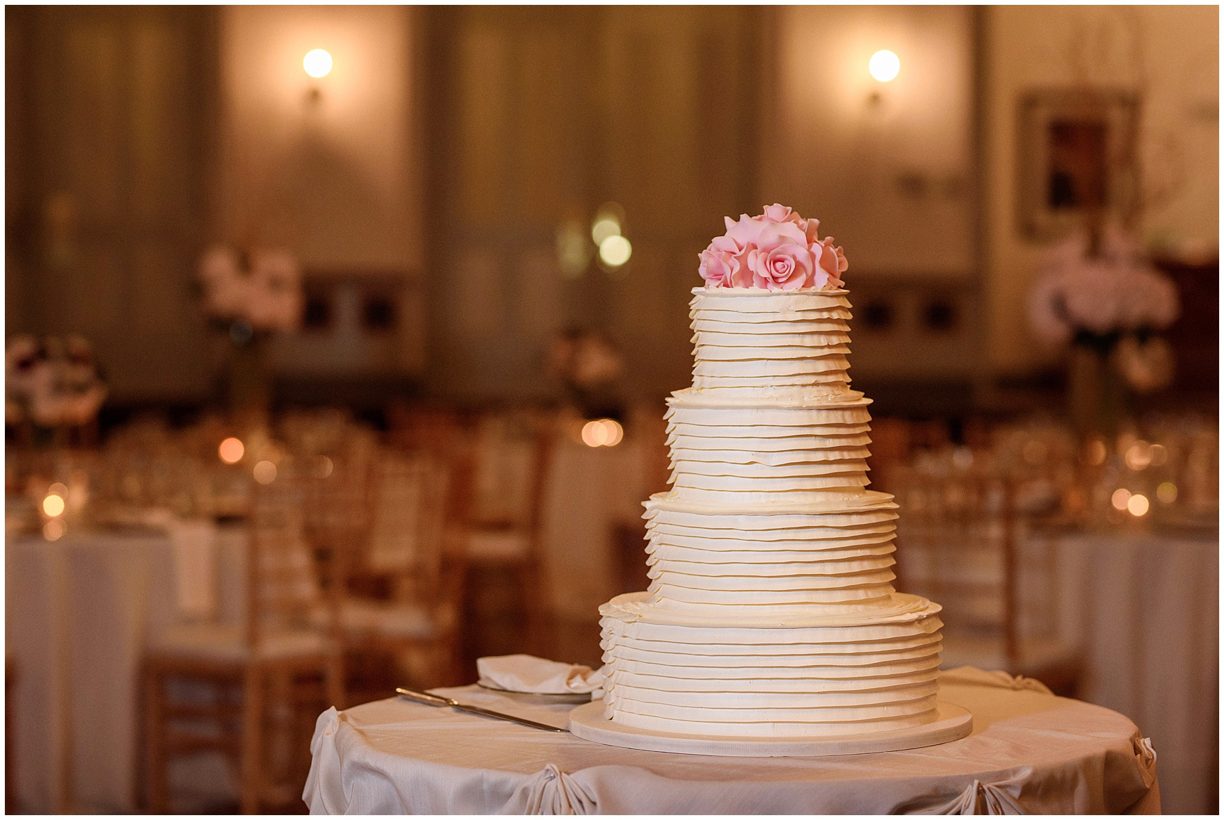 An elegant tiered wedding cake by Oak Mill Bakery during a St. Clement Germania Place Chicago wedding.