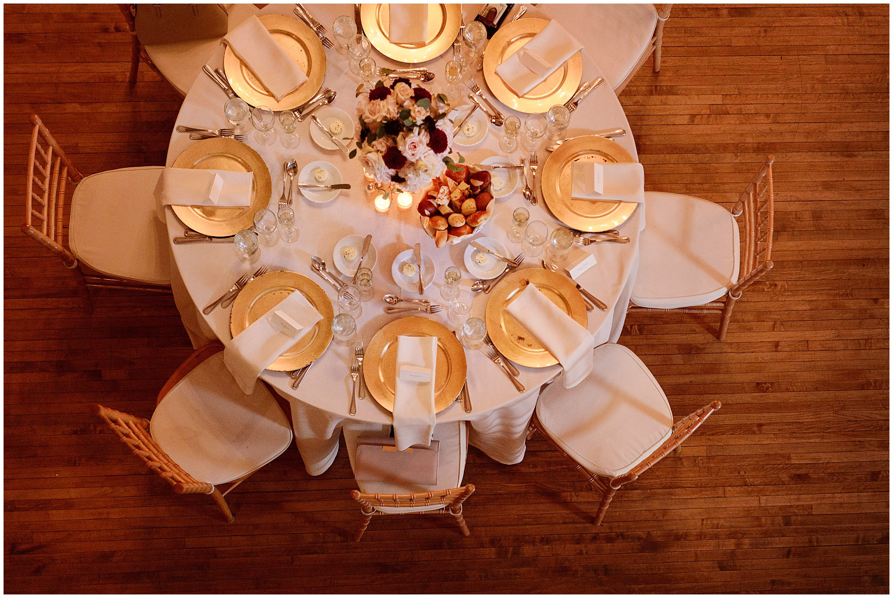 An overhead photograph of the fold and rose table setting during a St. Clement Germania Place Chicago wedding.