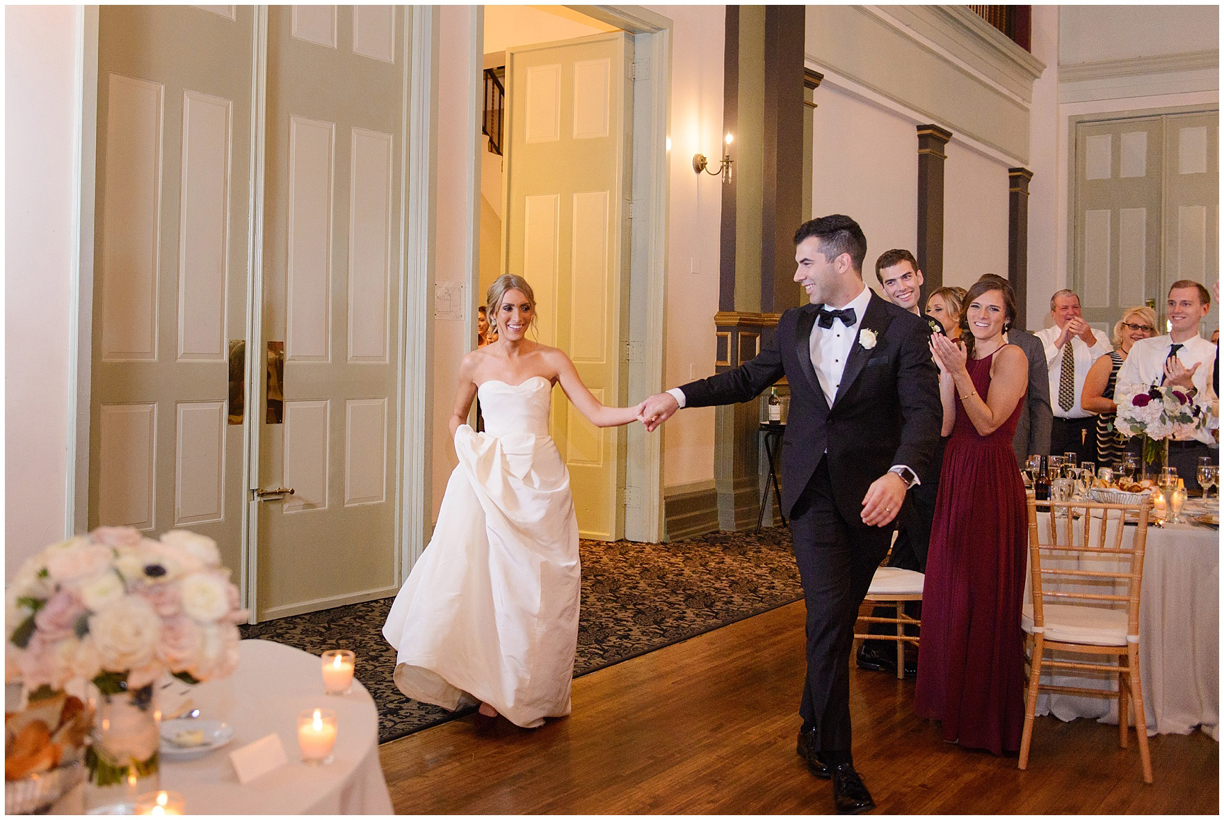 The bride and groom enter the reception to applause during a St. Clement Germania Place Chicago wedding.