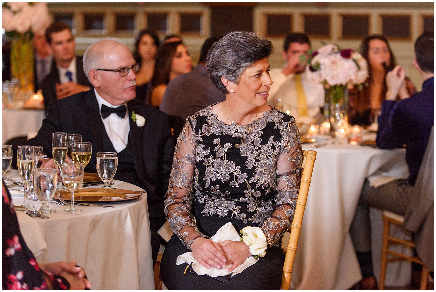 Guests listen to a toast during a St. Clement Germania Place Chicago wedding.