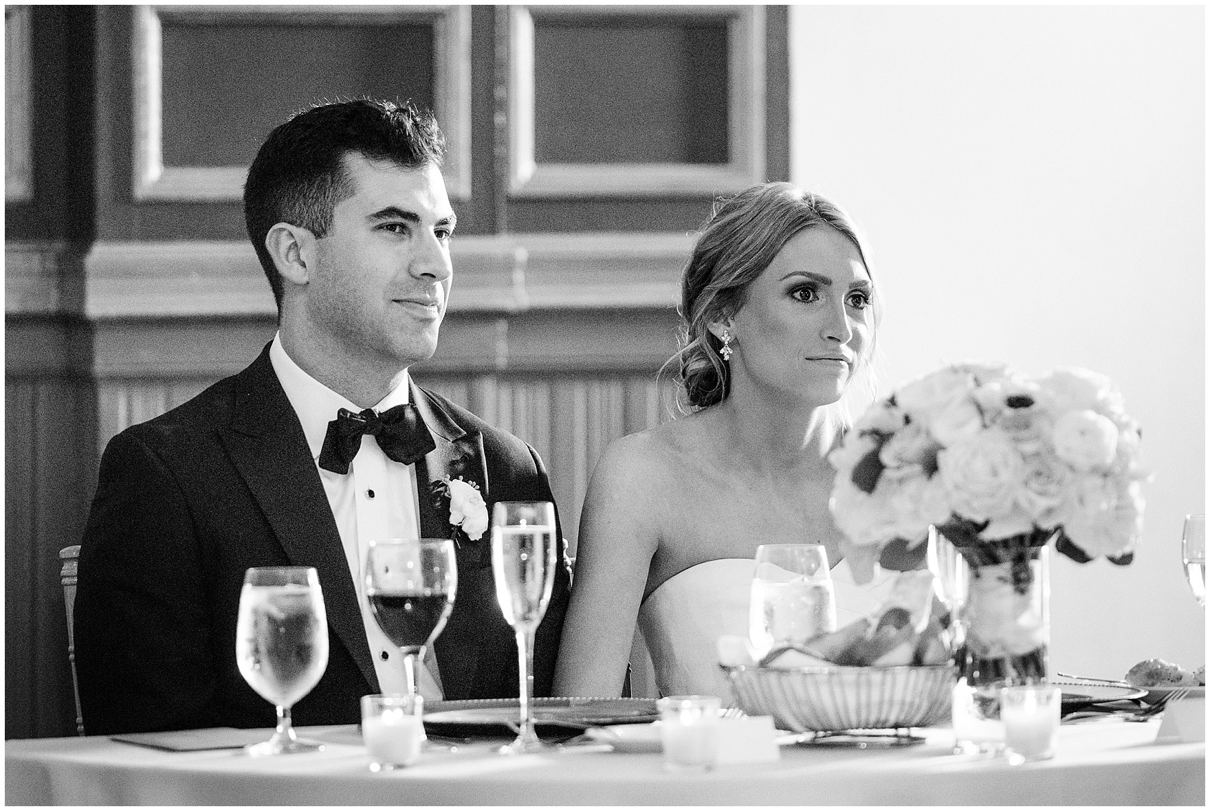 The bride and groom listen to toasts during a St. Clement Germania Place Chicago wedding.