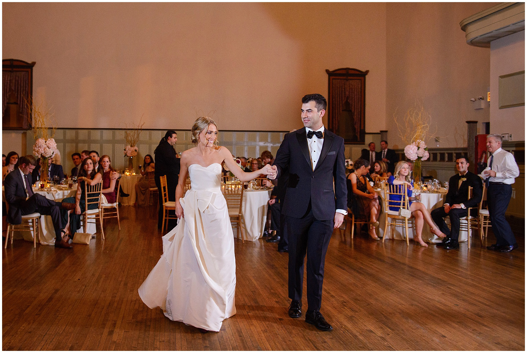 The bride and groom walk onto the dance floor for their first dance during a St. Clement Germania Place Chicago wedding.