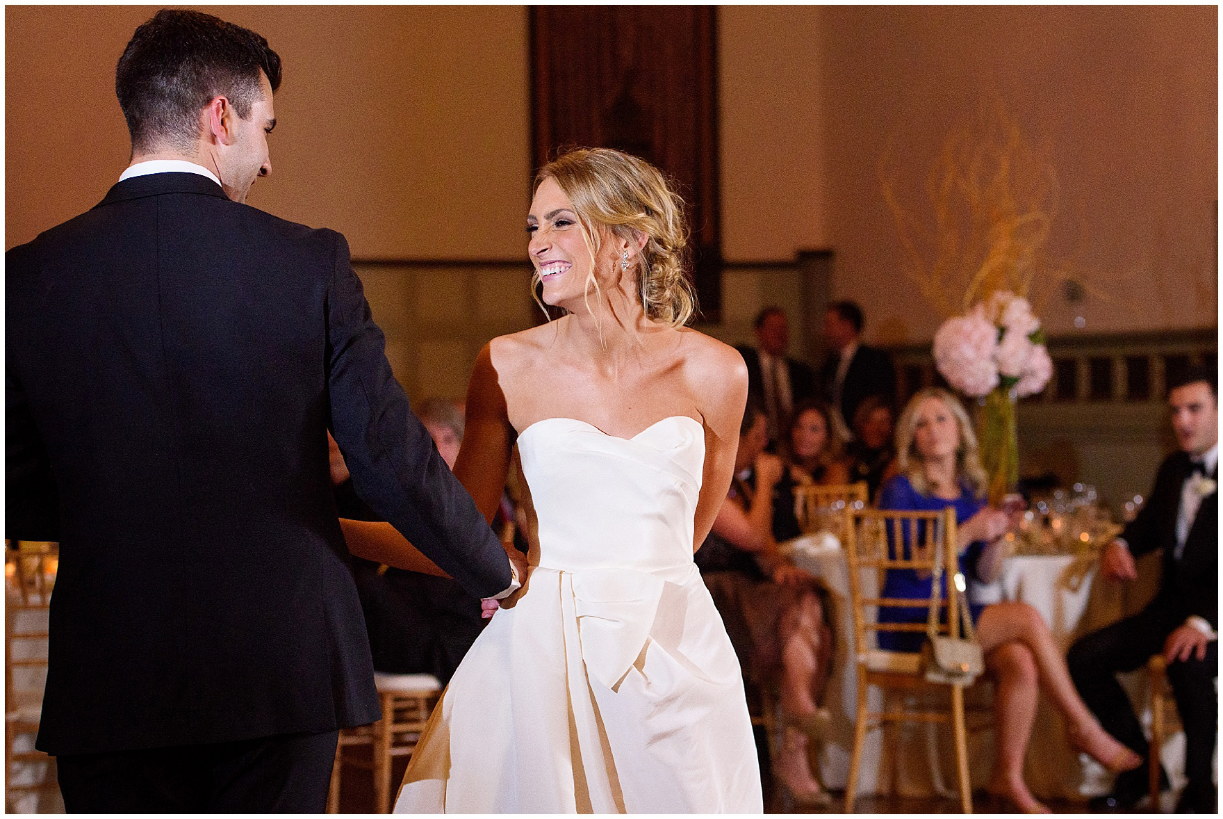 The bride and groom laugh during their first dance during a St. Clement Germania Place Chicago wedding.