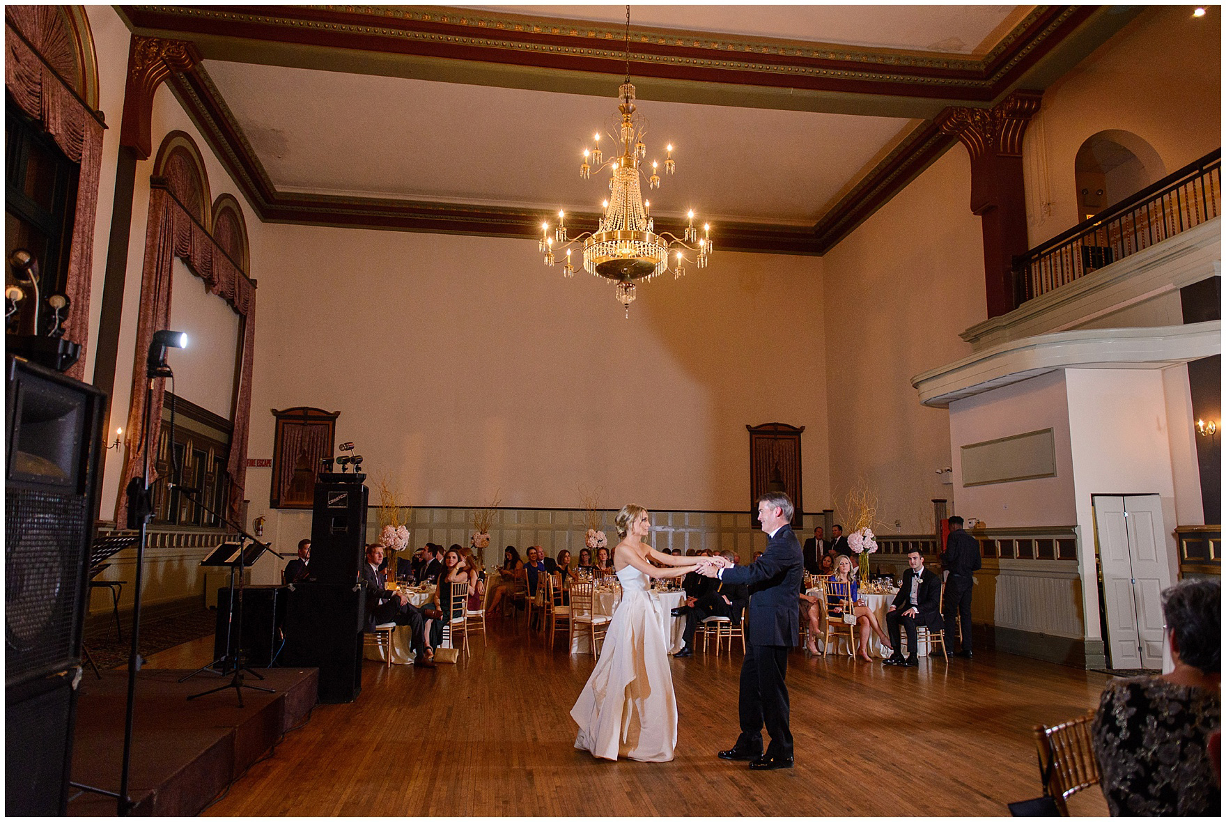 The bride dances with her father during a St. Clement Germania Place Chicago wedding.