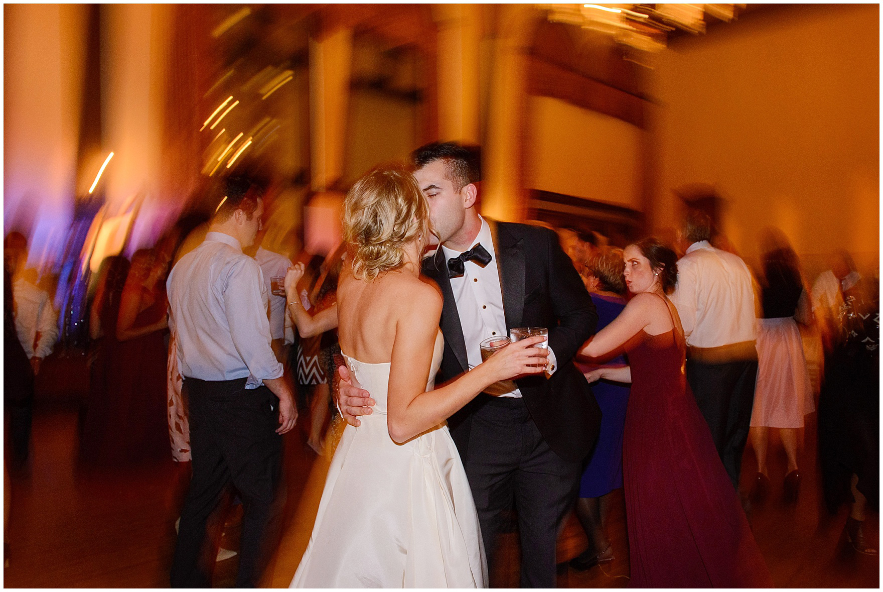The bride and groom kiss on the dance floor during a St. Clement Germania Place Chicago wedding.
