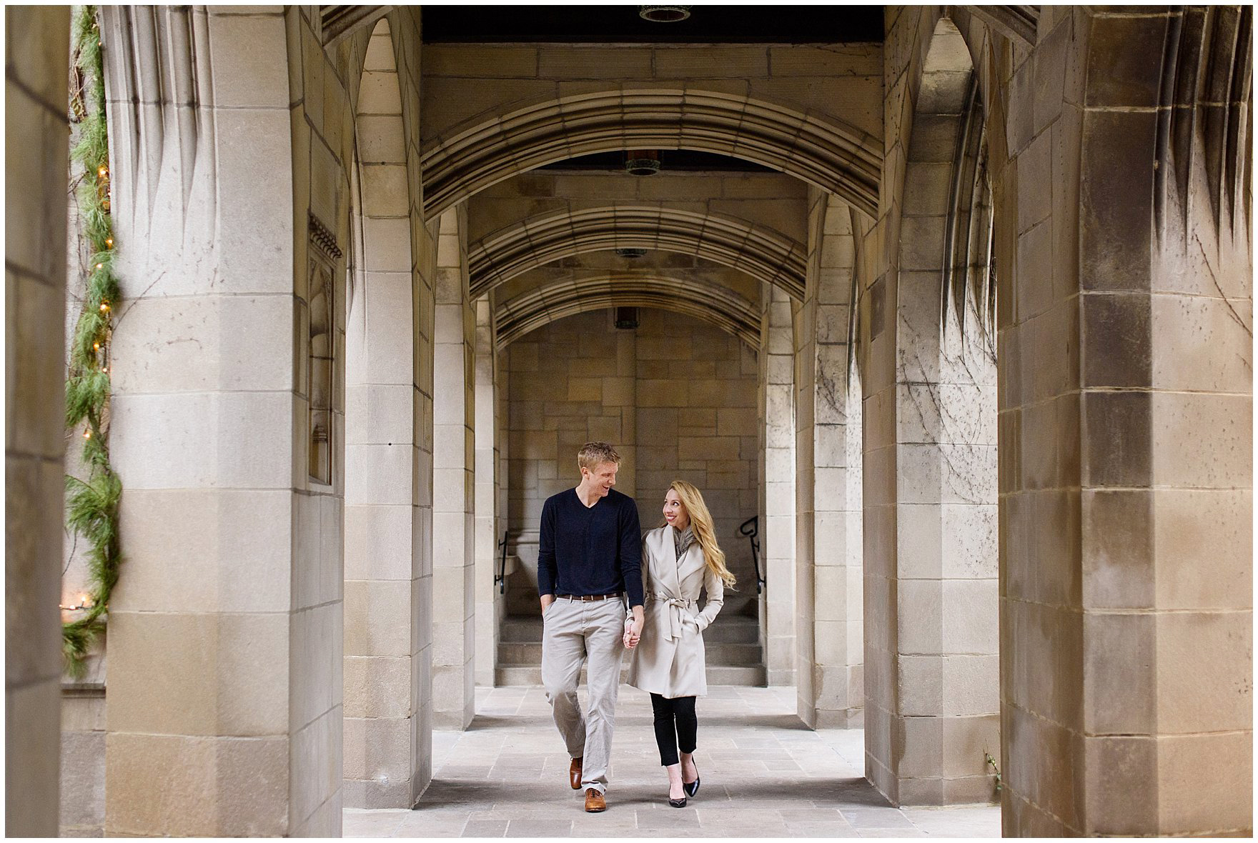 A couple walks under the covered archway at the Fourth Presbyterian Church during a downtown Chicago classic engagement photography session.