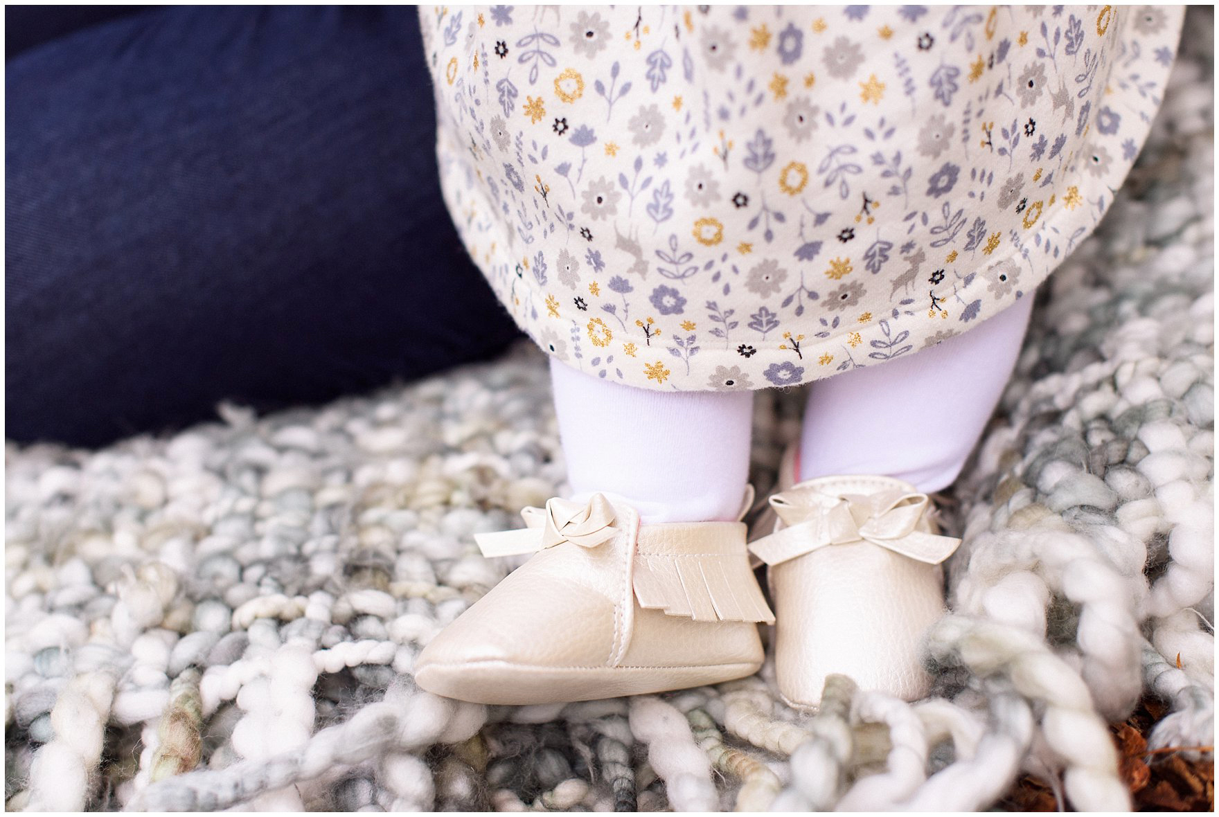 Close up of a baby's cute booties during a Morton Arboretum fall family session.