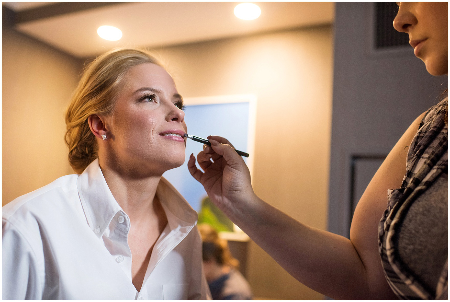A bride gets her makeup and hair done at the Gray Hotel Chicago before a Newberry Library Chicago wedding.