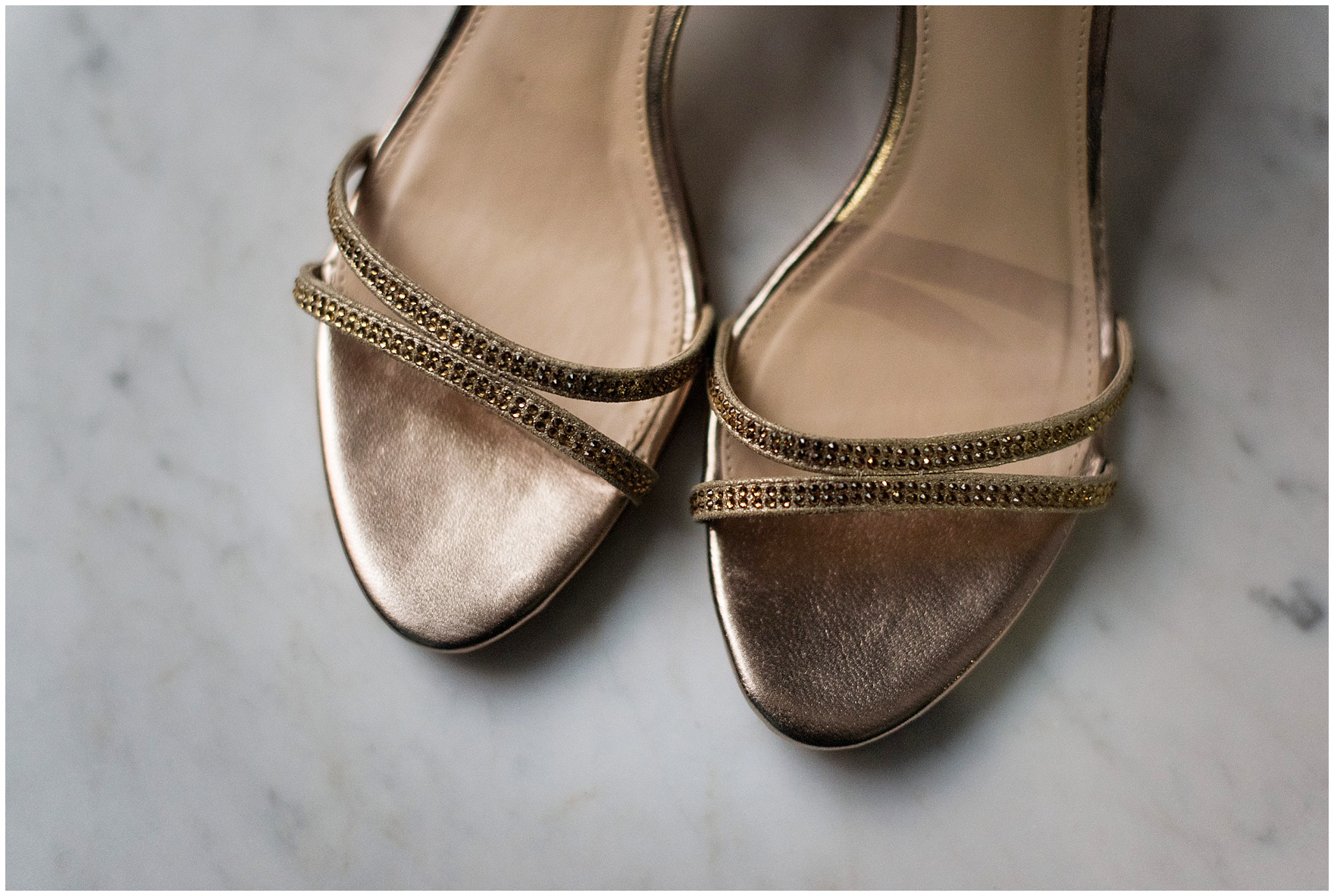 Detail of the bride's gold shoes for a Newberry Library Chicago wedding.