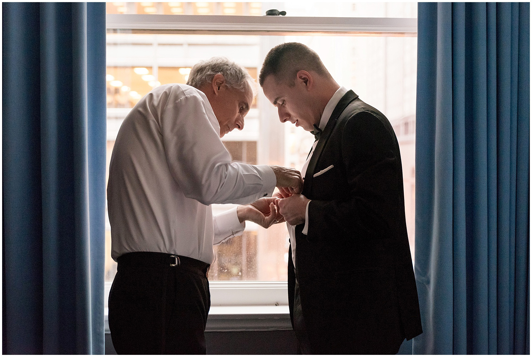 The groom's father helps him get ready at the Gray Hotel Chicago for a Newberry Library Chicago wedding.