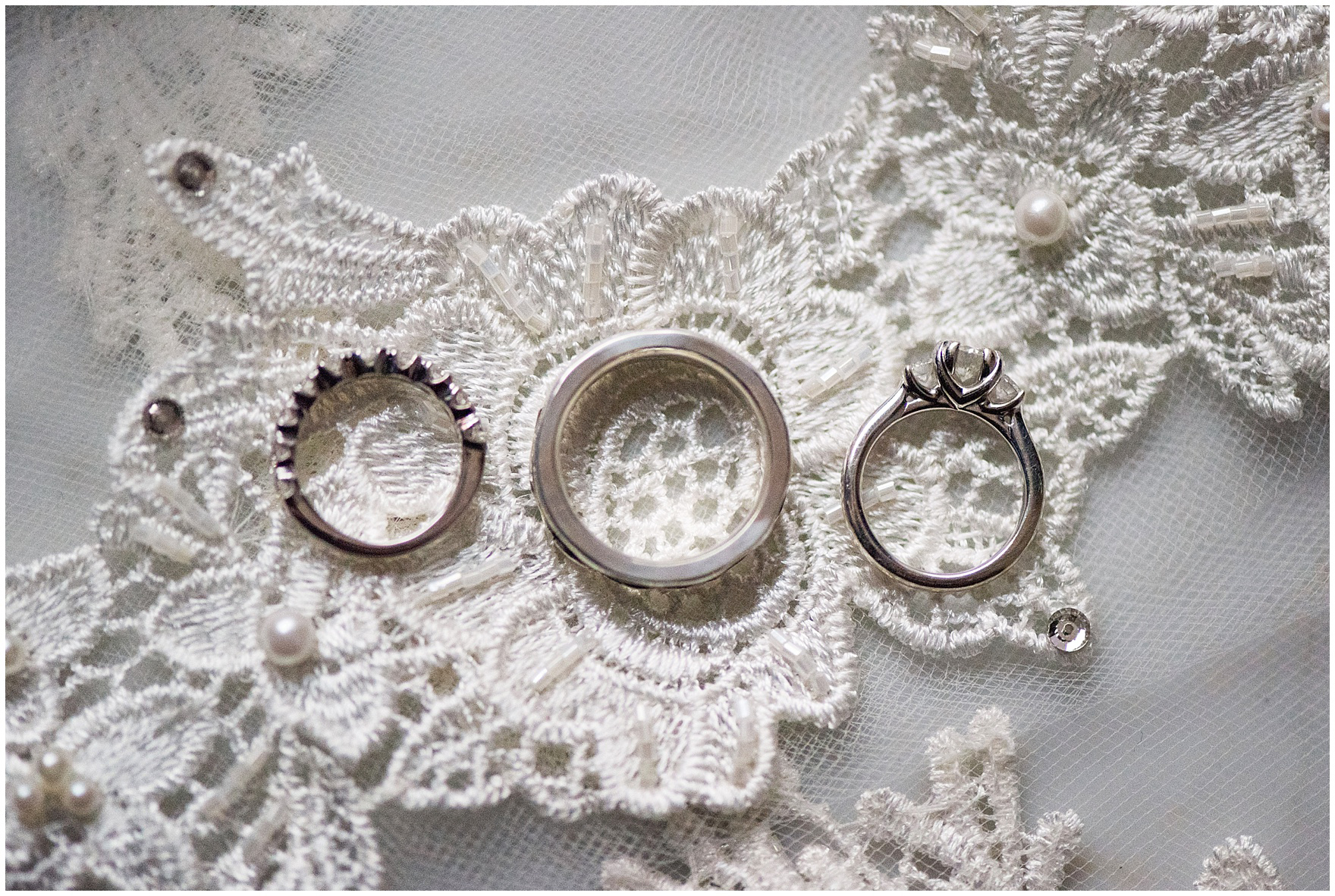 Details of the wedding rings on a lace veil for a Newberry Library Chicago wedding.