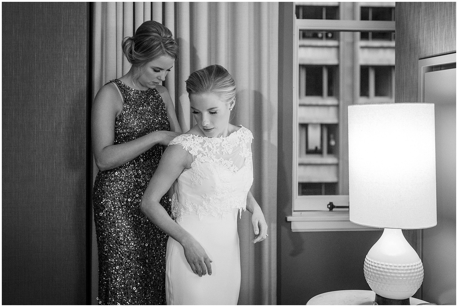 The bride puts on her dress at the Gray Hotel Chicago for a Newberry Library Chicago wedding.