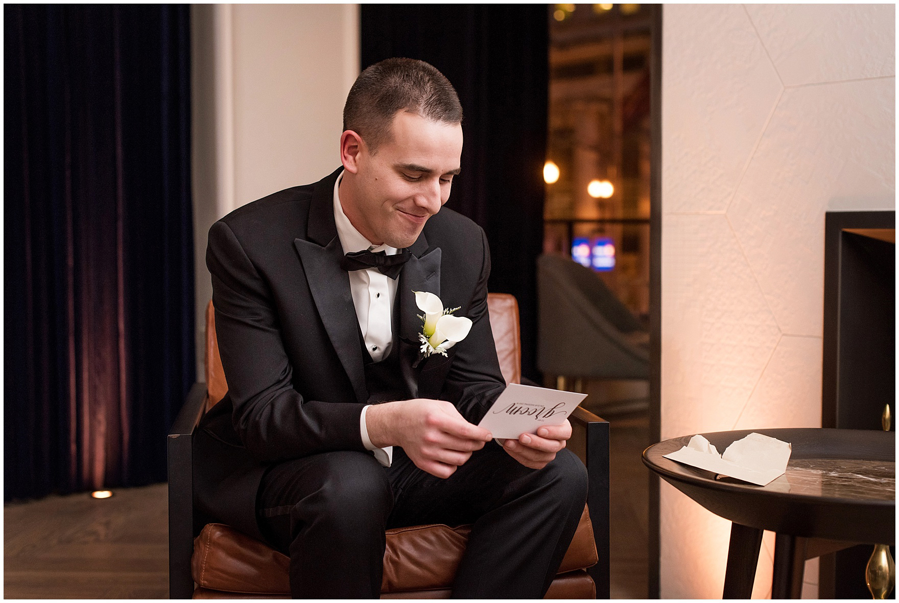 The groom reads a latter from his bride at the Gray Hotel Chicago for a Newberry Library Chicago wedding.