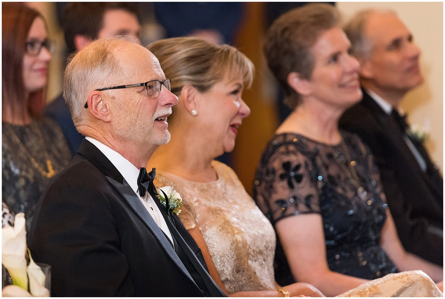 The bride's family laughs during a Newberry Library Chicago wedding.